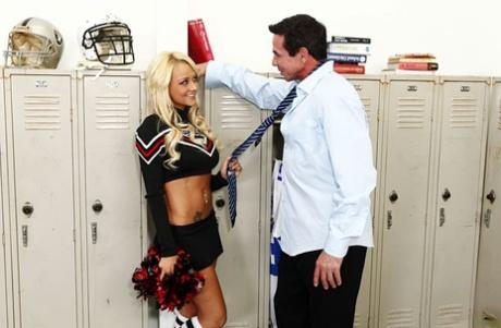 Blonde cheerleader Briana Blair getting fucked by Peter North in locker room