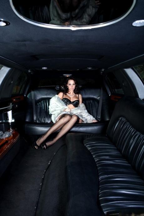 Brunette chick Chanel Preston removes her fur to model lingerie inside a limo