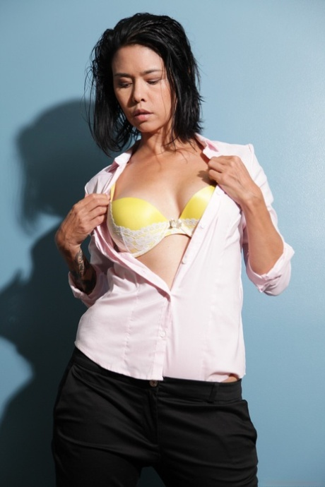 Asian female Dana Vespoli straddles Chanel Preston while taking her photo