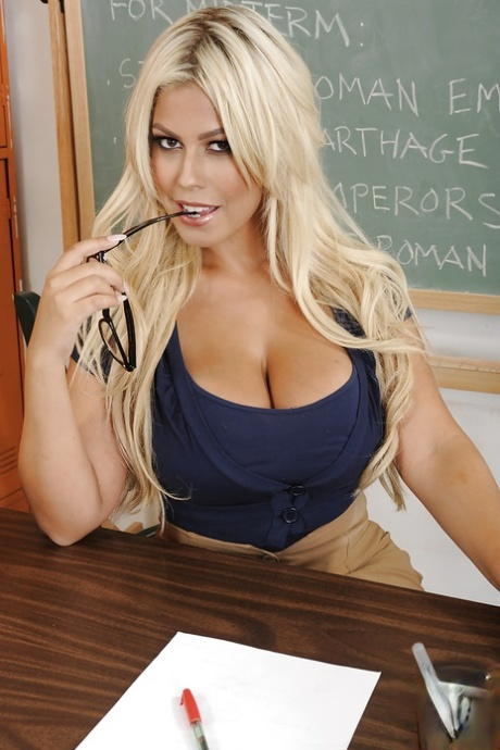 Juggy teacher undressing and spreading her nylon clad legs in the classroom