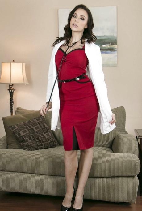 Brunette chick Chanel Preston releasing big tits from under doctor uniform