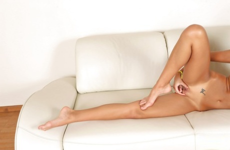 Leggy Euro chick Melena Maria frees barefeet from shoes and ass from shorts