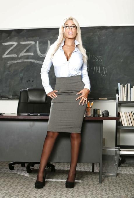 Latina schoolteacher Bridgette B undressing to display hooters in stockings