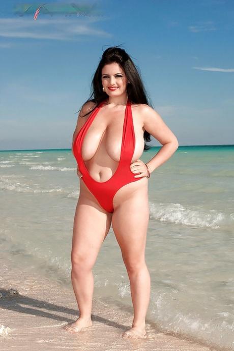 Chubby Arianna Sinn modeling in red bikini and exposing ripe boobs outdoor