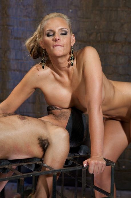 Busty blonde cougar Phoenix Marie rides sex slave's big dick and tortures him