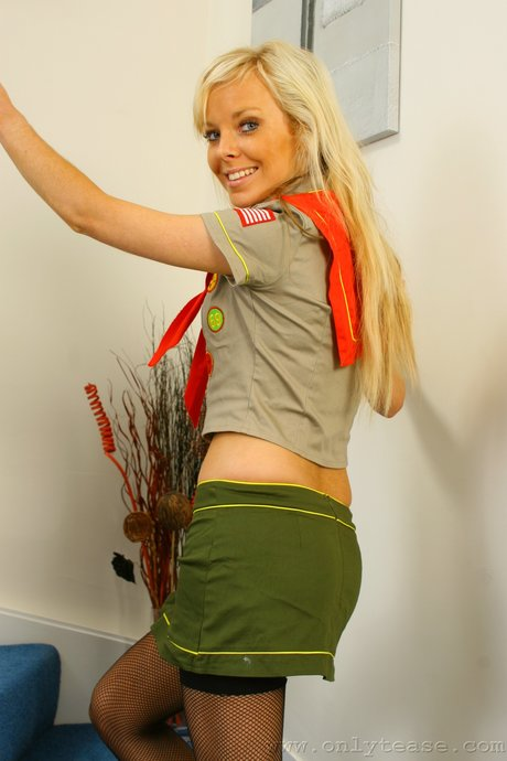 Blonde cutie Sue strips her park ranger outfit and poses in lingerie