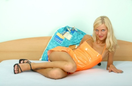 Blonde babe Kristy removes her dress and sticks a silver toy in her cunt