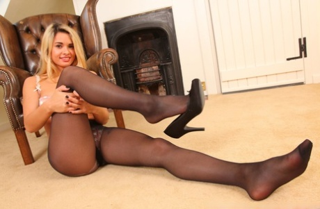 Sexy Danni B posing in leather wing chair in her black pantyhose - PornHugo.net