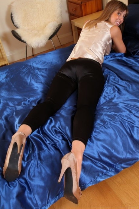 Long legged Michelle Burns gets rid of her satin pants and teases in lingerie - PornHugo.net