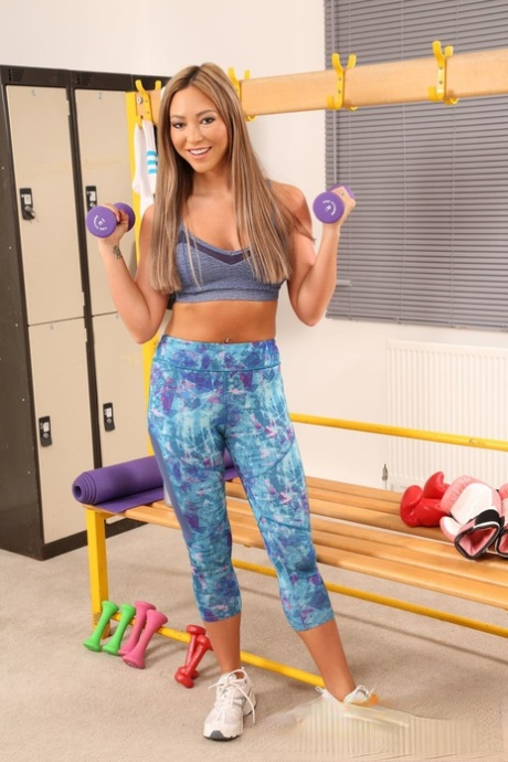 Hot Natalia Forrest shows her small tits and pierced belly while exercising
