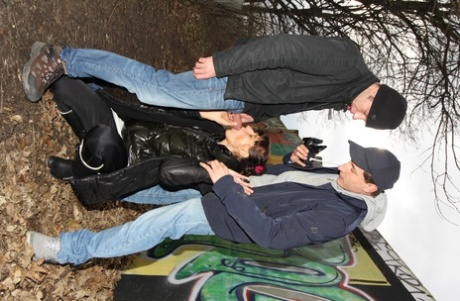 Amateur German babe Angelique gets banged by two horny guys outdoors