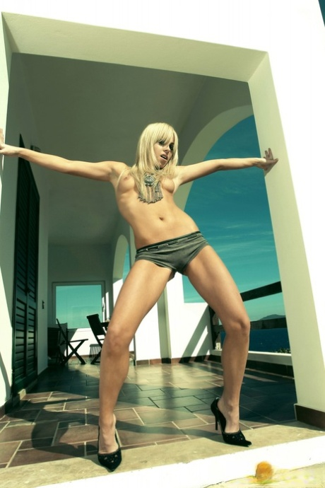 Hot European blonde Victoria Vass peels panties to sun tiny tits & bald pussy