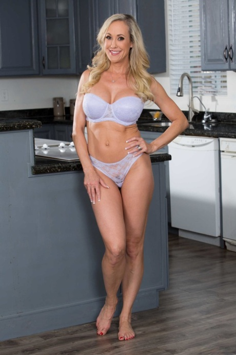 Hot blonde mature Brandi Love strips and makes you worship her big tits