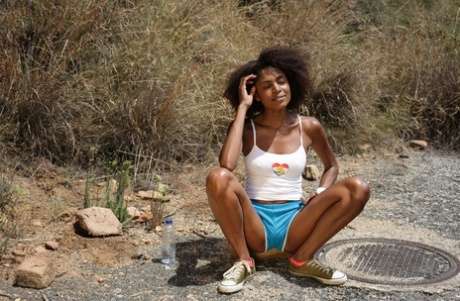 Curly-haired ebony teen Luna Corazonstrips in nature and touches herself
