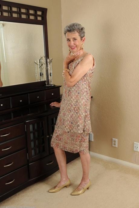 Slim granny Cassie doffs her dress and flaunts her bushy vagina