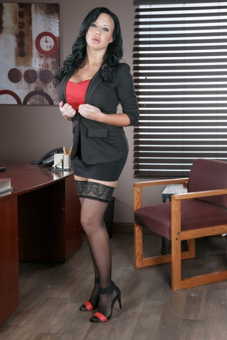 Sexy Brazilain MILF Sybil Stallone exposes her huge boobs at the office