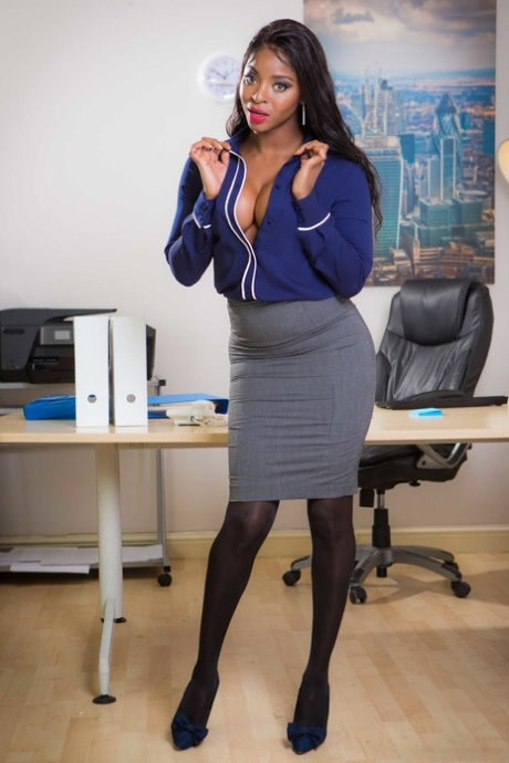 Hot ebony Jasmine Webb unveils her perfect fake tits in an office striptease