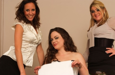 Clothed babes watch their friend stripping for two masked men on a chair