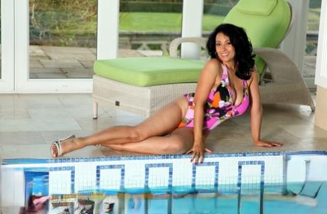 Hot British cougar Danica Collins unveils her monster tits poolside - PornHugo.net