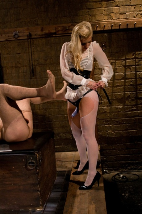 Blonde domme in lingerie Ashley Fires fucks a sex slave with a strapon
