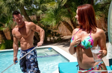 Busty redhead MILF Janet Mason gets her muff banged and jizzed by a pool guy