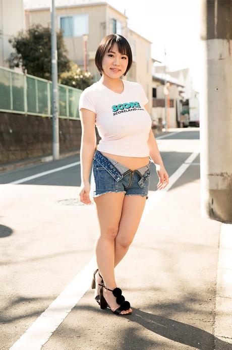 Asian hottie Kaho Shibuya reveals her huge bosom and poses nude on a desk