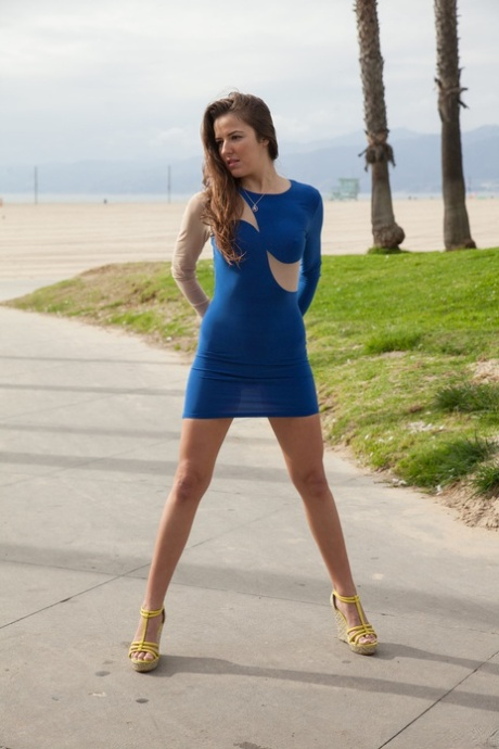Brunette teen Coco Rose flashes her tiny breasts and nice ass in public